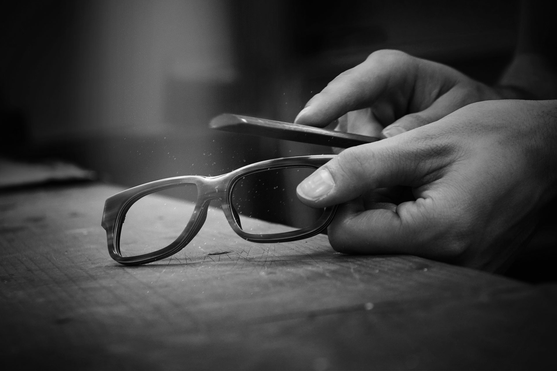 Tom Davies frames being filed by hand at the brand's London factory