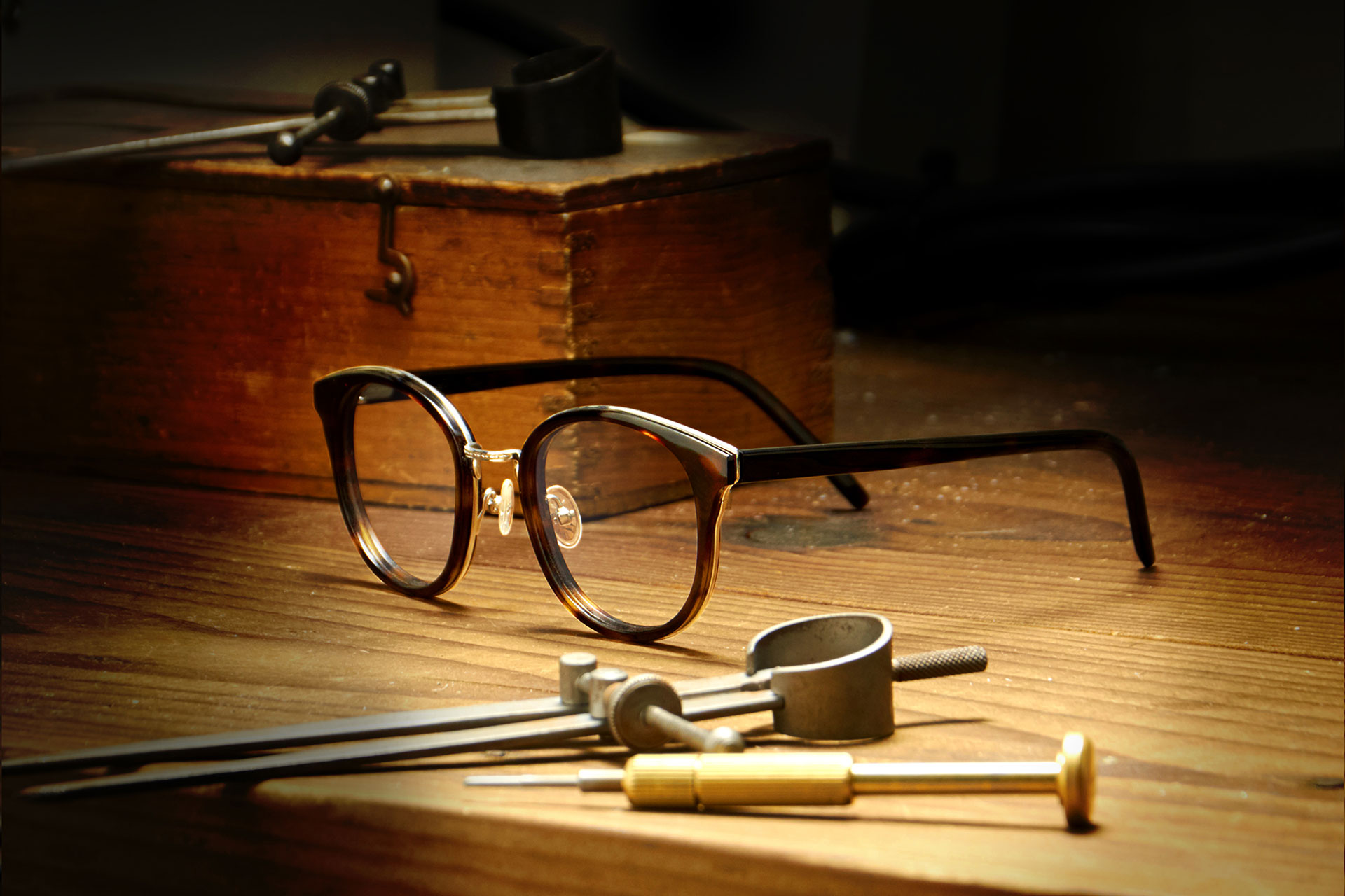 Tom Davies acetate frames and tools on wooden workbench in the brand's London factory
