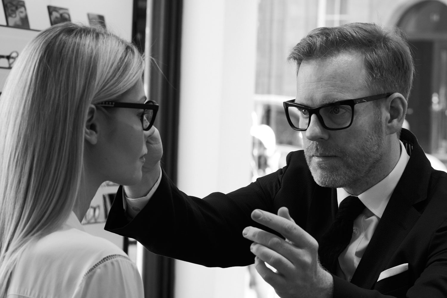 Bespoke eyewear designer Tom Davies during a bespoke consultation with a female customer